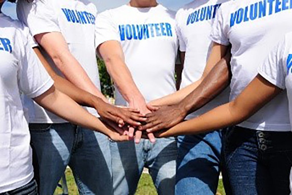 Volunteers joining hands